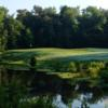 A view over the water of the 14th hole at Grand Bear Golf Course